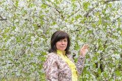 Portrait of brunette cherry orchard Stock Photo
