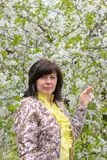 Portrait of brunette cherry orchard Stock Images