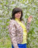 Portrait of brunette cherry orchard Royalty Free Stock Images