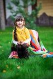 Portrait of brunette child girl sitting outdoors Stock Images