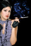 Portrait of a brunette with cigarette holder Royalty Free Stock Images