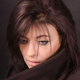 Portrait of brunette on a dark Royalty Free Stock Photo