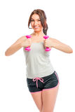 Portrait of a brunette with dumbbells Royalty Free Stock Photos
