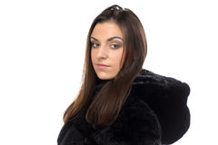 Portrait of brunette in fake fur coat with hood Royalty Free Stock Images