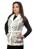 Portrait of the brunette in fake fur waistcoat Royalty Free Stock Photos