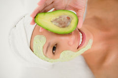 Portrait  of a brunette getting a facial treatment Stock Images