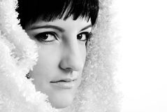 Portrait of brunette girl. Portrait of a beautiful brunette in winter scarf. Black and white image royalty free stock images