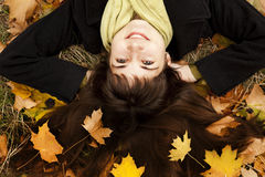 Portrait of brunette girl in the autumn park. Royalty Free Stock Photo