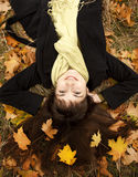 Portrait of brunette girl in the autumn park. Royalty Free Stock Photography