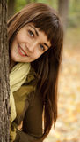 Portrait of brunette girl in the autumn park. Stock Photos