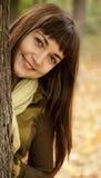 Portrait of brunette girl in the autumn park. Stock Photos
