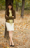 Portrait of brunette girl in the autumn park. Royalty Free Stock Image