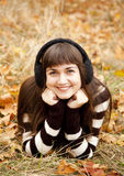 Portrait of brunette girl in the autumn park. Stock Images