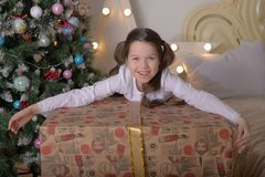 Portrait of brunette girl with a huge gift stock photos
