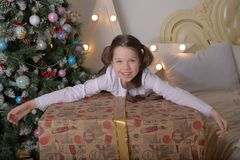 Portrait of brunette girl with a huge gift stock photography