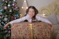 Portrait of brunette girl with a huge gift royalty free stock photos