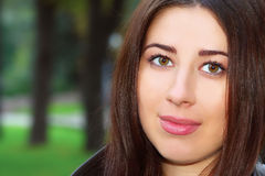 Portrait of brunette girl in the park Royalty Free Stock Photo