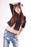 Portrait of brunette girl with slim body in jeans and shirt Stock Image