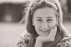 Portrait of brunette girl on sunny spring or summer day in park Stock Images