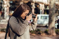 Portrait of brunette girl taking pictures stock photos