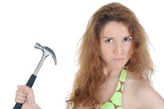 Portrait of a brunette with a hammer Royalty Free Stock Images