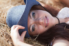 Portrait of brunette in hat Stock Photos