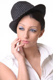 Portrait of a brunette in hat Royalty Free Stock Photography