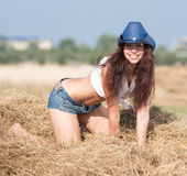 Portrait of brunette in hat at the field Stock Photography