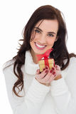 Portrait of a brunette holding gild gift Stock Photography