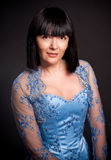 Portrait of brunette lady with short haircut and in blue corset Royalty Free Stock Photos