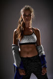 Portrait of a brunette lady in sport clothes Royalty Free Stock Images