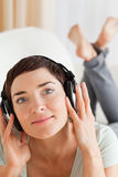 Portrait of a brunette listening to music Royalty Free Stock Photo