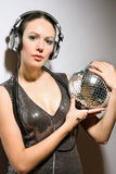 Portrait of brunette with a mirror ball Stock Images