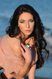 Portrait of brunette model posing on the beach Stock Images