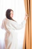 Portrait of a brunette near the window Stock Photos