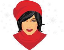 Portrait of brunette in a red knitted cap Stock Image