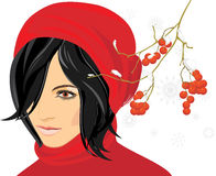 Portrait of brunette in a red knitted cap Royalty Free Stock Photography