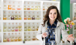 Portrait of  brunette shopping in perfume store. Portrait of happy american brunette shopping in perfume store Stock Images
