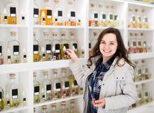 Portrait of  brunette shopping in perfume store. Portrait of happy european  brunette shopping in perfume store Stock Images
