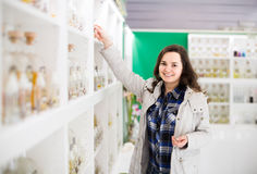 Portrait of  brunette shopping in perfume store. Portrait of happy spanish  brunette shopping in perfume store Royalty Free Stock Images
