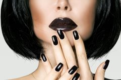 Portrait of brunette in short black hair,. Black lipstick and black nails Royalty Free Stock Image