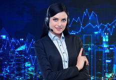 Portrait of brunette support phone operator with the headset. Royalty Free Stock Image