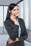 Portrait of brunette support phone operator with the headset. Stock Images