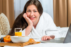 Portrait of a brunette with a tray of food Stock Image