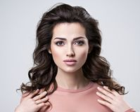 Yonug Brunette woman with long hair royalty free stock photography
