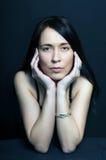 Portrait brunette  woman on black background Royalty Free Stock Photography