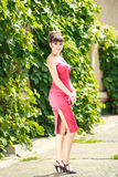 Portrait of a brunette woman with bright makeup. In a skin-tight red dress Royalty Free Stock Photos