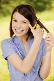 Portrait of brunette woman cutting Royalty Free Stock Photography