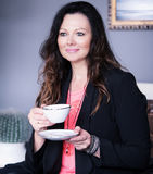 Portrait of brunette woman drinking coffee Royalty Free Stock Photography
