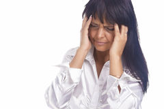 Portrait of Brunette Woman Experiencing Headache in Forehead Royalty Free Stock Photo
